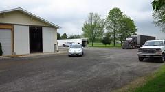 asphalt, garage, property, driveway, yard, residential area, real estate, home, tarmac,
