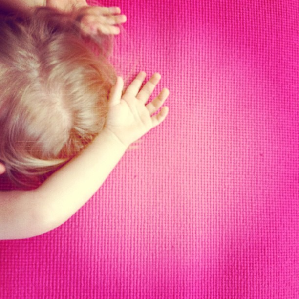 Doing yoga with Mommy this morning.