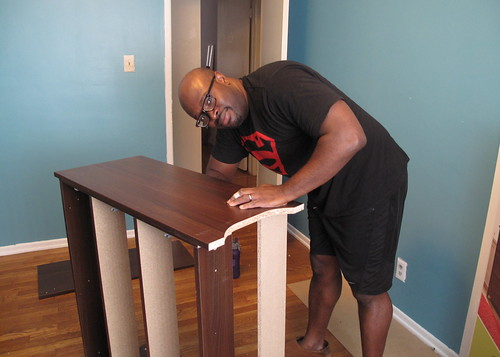 Sean on furniture assembly duty