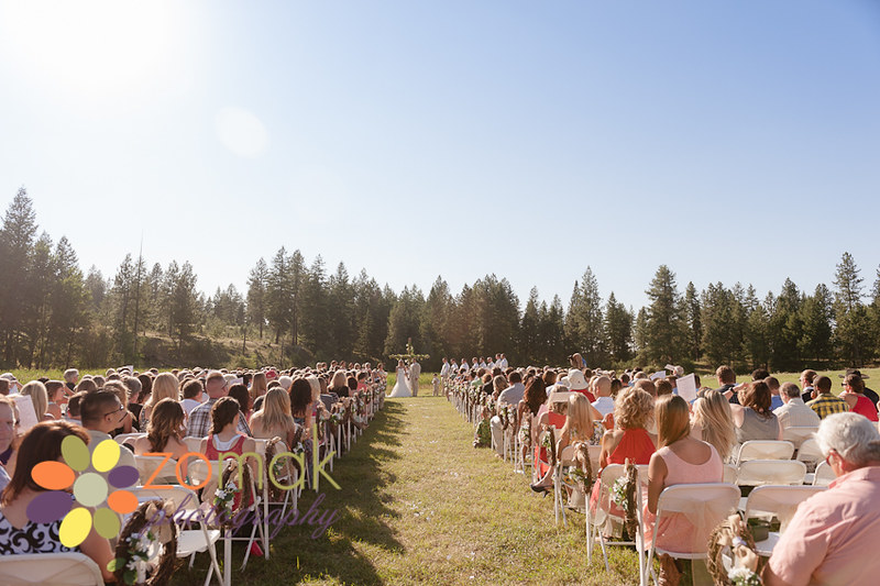 Wide angle shot of outdoor wedding ceremony with five hundred guests