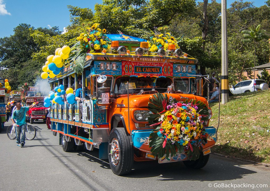 A vendor tries to sell sprayable carnival foam to passengers on this chiva from El Carmen