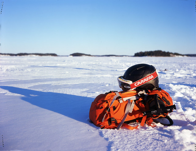 Backpack and helmet on ice