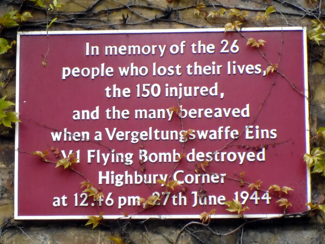 flying bomb (V1/V2) maroon plaque - In memory of the 26 people who lost their lives, the 150 injured, and the many bereaved when a Vergeltungswaffe Eins V1 Flying Bomb destroyed Highbury Corner at 12.46pm, 27th June, 1944