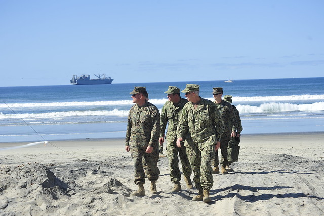 CORONADO, Calif. - Rear Adm. Gerard P. Hueber, commander of Expeditionary Strike Group (ESG) 3, and Brig. Gen. John J. Broadmeadow, commanding general of 1st Marine Logistics Group and 1st Marine Expeditionary Brigade, tour the amphibious landing site at Green's Beach during exercise Brilliant Scepter 2013.
