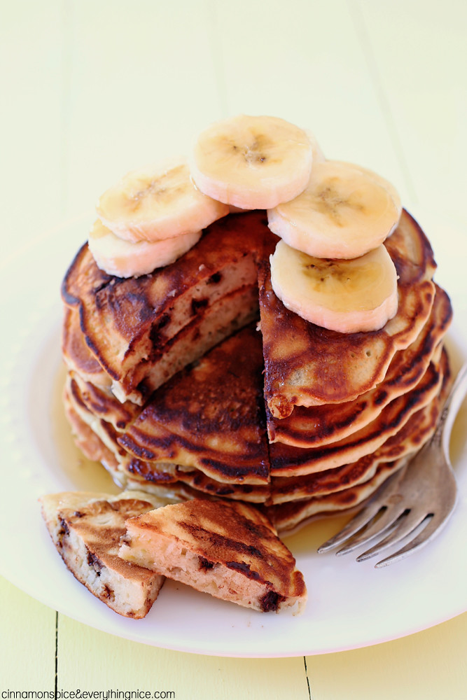 Chocolate Chip Banana Pancakes - Thick and fluffy with bananas two ways and mini chocolate chips speckling the batter. Simply irresistible! | cinnamonspiceandeverythingnice.com