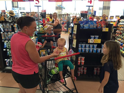A little girl at the supermarket comes up to meet the twins