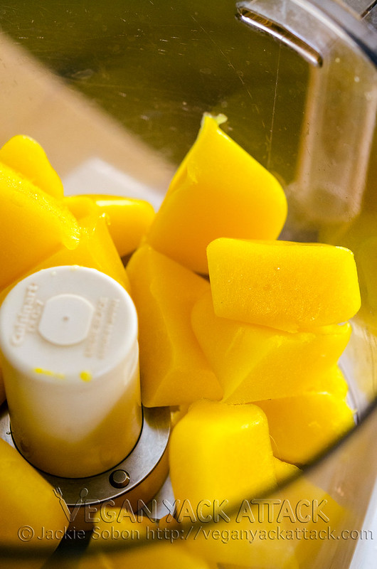 Frozen mango cubes in a food processor