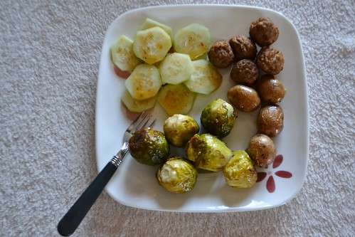 Vegan Meatballs, Baked Potatoes, Roasted Brussels Sprouts, and Sliced Cucumbers