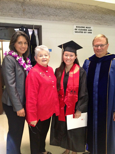 <p>University of Hawaii President M.R.C. Greenwood, U.S. Representative Tulsi Gabbard, a newly minted UH Hilo graduate and UH Hilo Chancellor Don Straney at UH Hilo's graduation ceremony on Saturday, May, 2013.</p>