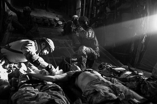 <p>U.S. Airmen assigned to the 82nd Expeditionary Rescue Squadron provide medical care to simulated patients during a combat search and rescue exercise on board an MC-130P Combat Shadow aircraft over the Grand Bara Desert, Djibouti, May 12, 2013. The 449th Air Expeditionary Group regularly conducted training in support of Combined Joint Task Force-Horn of Africa (CJTF-HOA). CJTF-HOA conducts operations in the combined-joint operations area to enhance partner nation capacity, promote regional security and stability, dissuade conflict and protect US interest.(DoD photo by Airman 1st Class Nicholas Byers, U.S. Air Force/Released)</p>