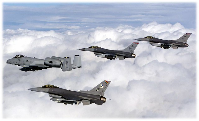 Spangdahlem aircraft fly in formation. The A-10 flies with F-16s from the 22nd Fighter Squadron, 23rd Fighter Squadron, and the 52nd Fighter Wing flagship