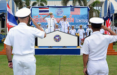 U.S. Rear Adm. William McQuilkin and Royal Thai Navy Rear Adm. Paitoon Prasopsin speak to exercise participants and guests during the opening ceremony of CARAT Thailand, June 3. (U.S. Navy photo by MC1 Jay C. Pugh)