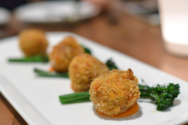 Potato Crusted Smoked Pork Shank romesco, charred broccolini