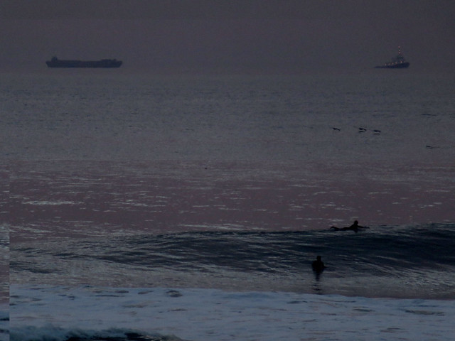 surfers, boats, and pelicans at sunset on Ocean Beach; Judah and Great Highway; The Outer Sunset, San Francisco (January 26, 2015)
