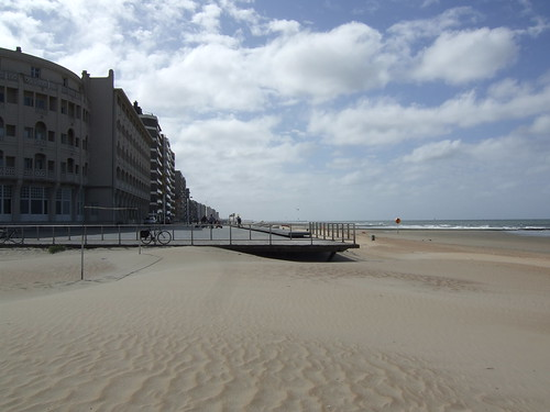 white sandy beach and buildings