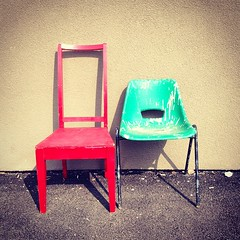 Red chair has a green companion. #photography #art #red #green #chairs #shadows #lonely #companionship #empty