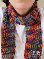 Colorful mesh scarf being modeled around a neck.