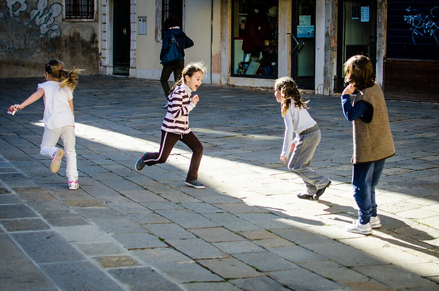 Kids playing in a square in Venice.