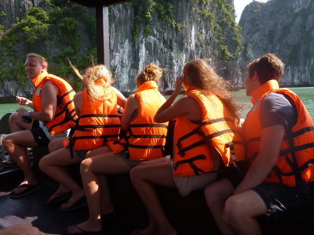 Bright orange life jackets to go kayaking in Halong Bay