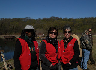 Volunteers Assist Kids at the Open Fishing Station