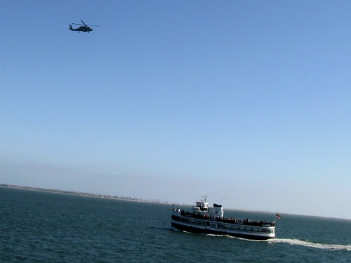 A United States Navy helicopter and a sightseeing cruise boat.  San Diego California.  June 2013. by Eddie from Chicago