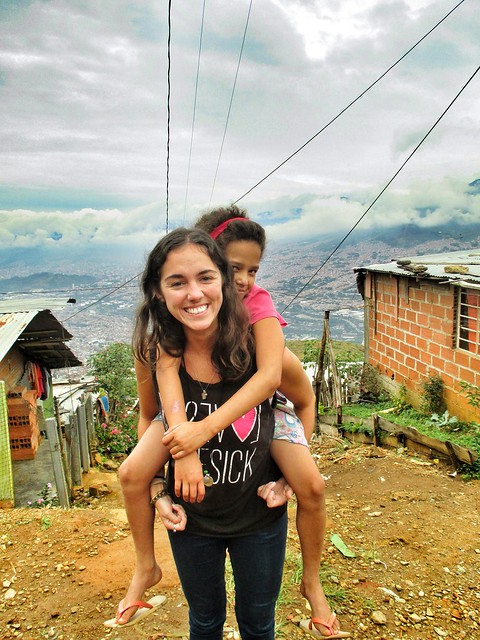Volunteer and child above Medellin