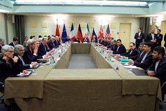 U.S. Secretary of State John Kerry sits with his counterparts from Germany, China, the European Union, France, the United Kingdom, and Russia on March 30, 2015, in Lausanne, Switzerland, before the P5+1 partner nations resume direct negotiations with Iranian officials, top and right, about the future of their country's nuclear program. [State Department Photo / Public Domain]