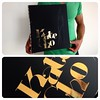 Custom matte black Fashion Design portfolio book with gold vinyl decal inlay + engraving treatment