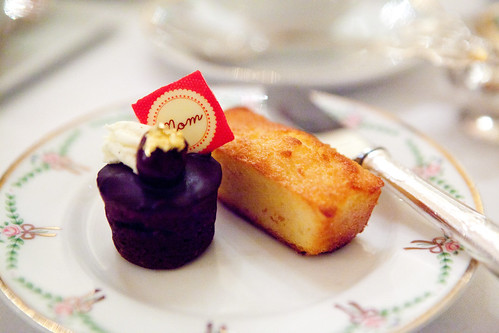 "Gateau de Voyage cake topped with a chocolate ""Mom"" sign and financier"