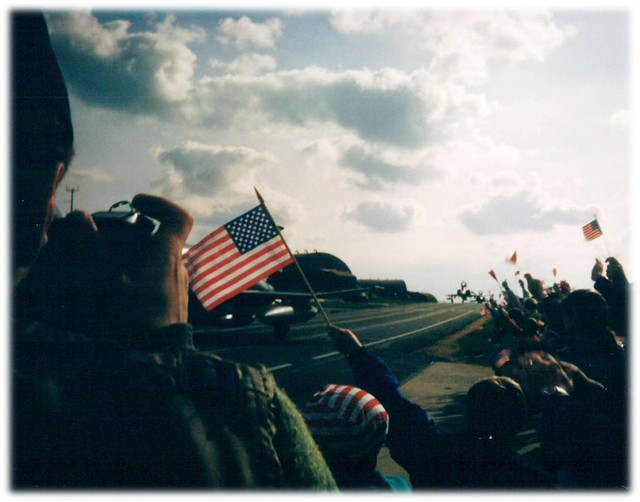 Sabers wave American flags as F-4s from the 81st return after Desert Storm