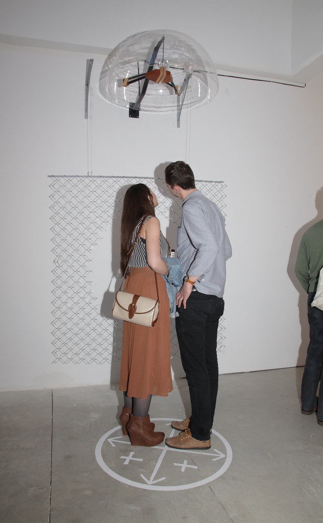 Guests interact with the audio sculpture by Mariamma Kambon (M.F.A. '14).