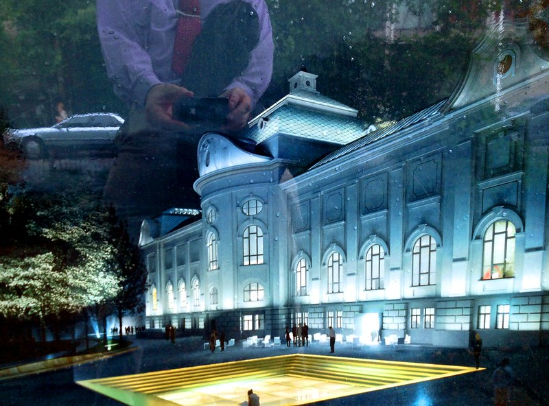 An artistic take on the rendering of the Latvian Art Museum. It's me taking the picture in the background. by aigarsbruvelis