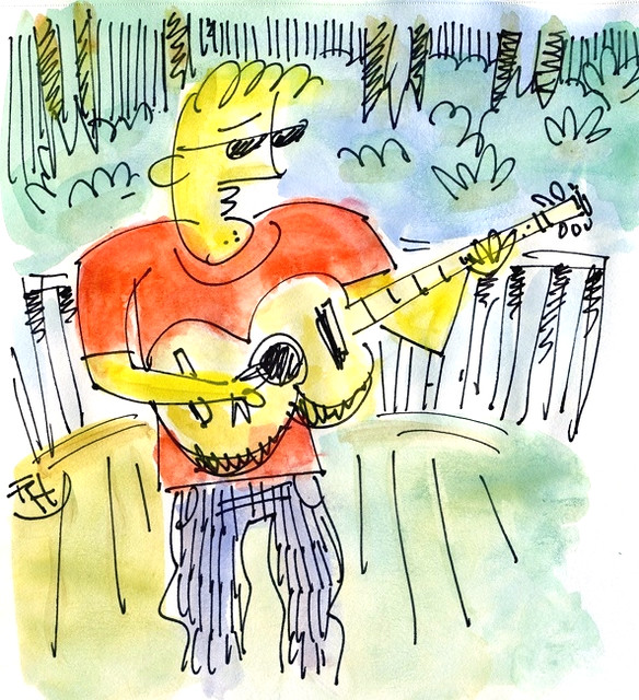 colored guitarist with t-shirt on a deck