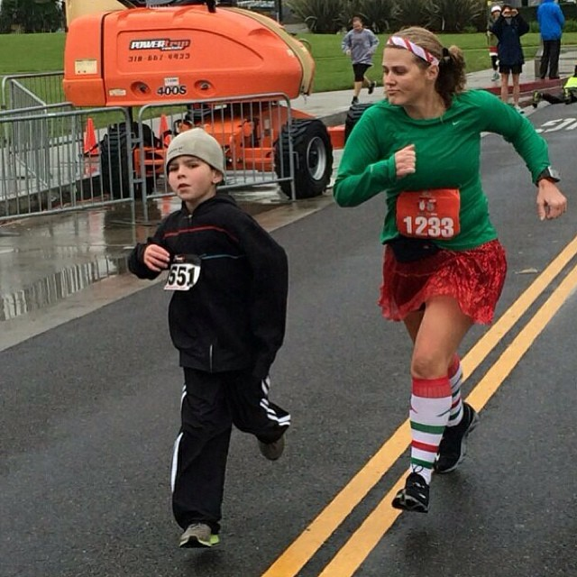 "Chasing after my son at the Santa Monica-Venice Christmas Run on Saturday. It was raining and he wasn't ""moving"" fast enough. Husband says ""You look like an angry duck chasing him down."" I was wet and cold, I wanted to go home asap! #christmasrun #teamspa"