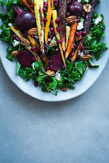 Kale super salad with roasted vegetables, pomegranate, ricotta, nuts