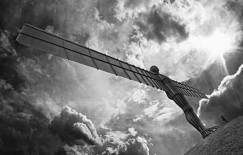 sky blackandwhite bw statue angel clouds newcastle mono rust steel north dramatic structure gateshead figure 5d publicart dramaticsky angelofthenorth antonygormley hss northeastengland eos5d cloudsstormssunsetssunrises sliderssunday orangecapri