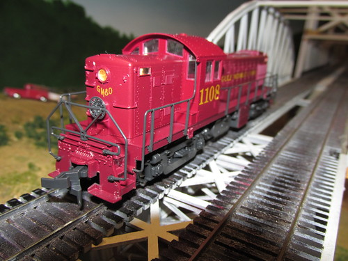 A 1940's era Gulf, Mobile & Ohio Railroad Alco model R S 1 roadswitcher diesel electric locomotive running light. by Eddie from Chicago