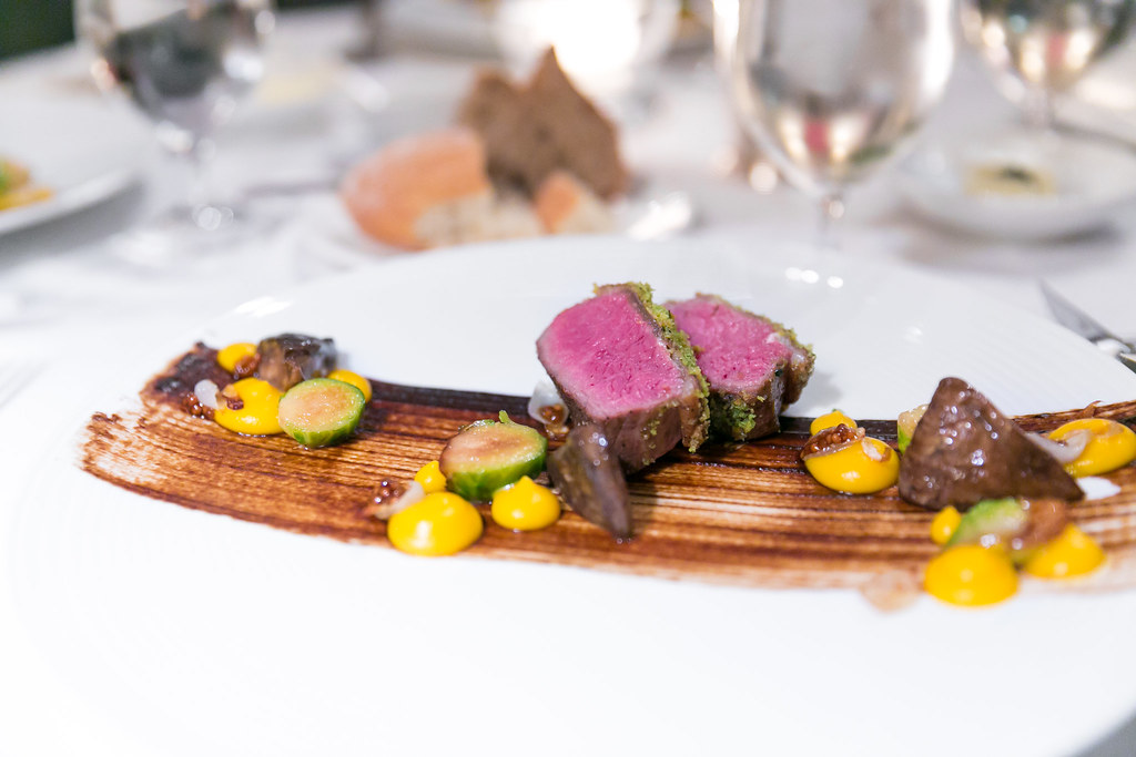 Pinenut-herb crusted rack of lamb with portabella mushroom, Brussels sprouts, and black garlic