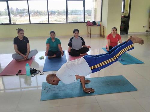 Yoga guru suneel singh in peacock pose