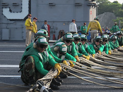Sailors aboard USS George Washington (CVN 73) prepare to raise the emergency aircraft barricade during crew certification drills on the flight deck, May 15. (U.S. Navy photo by Mass Communication Specialist 2nd Class Jacob I. Allison)