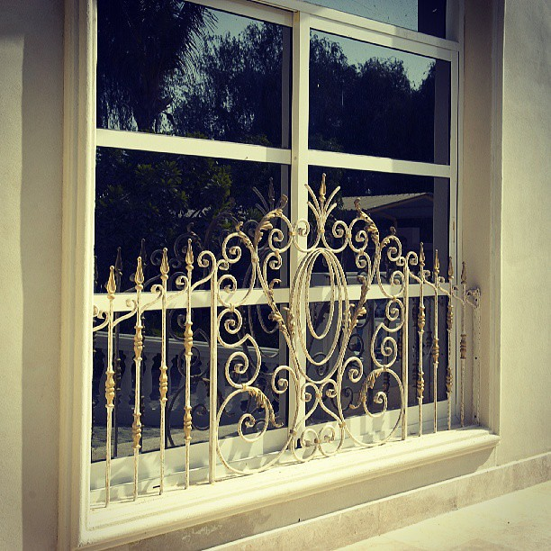 Window wrought iron villa house home ad abudhabi for Iron window design house