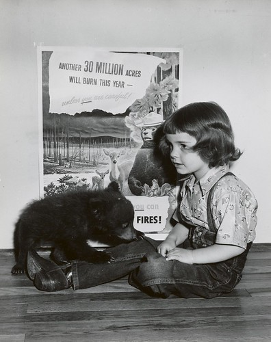 Judy Bell and Smokey Bear. Taken shortly after Smokey had been rescued from the Forest Fire in May 1950. (U.S. Forest Service photo)