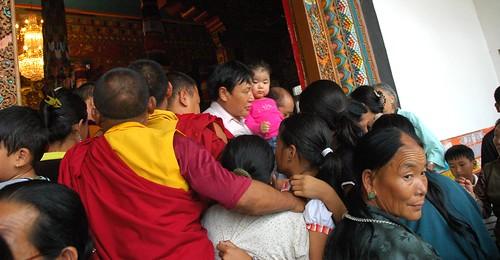 Crush of Tibetan Buddhist crowd coming and going from the front entrance of Tharlam Monastery, monks, Manang woman, kids, initiation, Sakya Lamdre, Boudha, Kathmandu, Nepal by Wonderlane