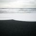 Black sand beaches by Bryn Tassell