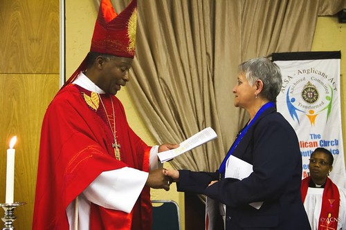Archbishop Thabo confers the Order of Simon of Cyrene on two Church members