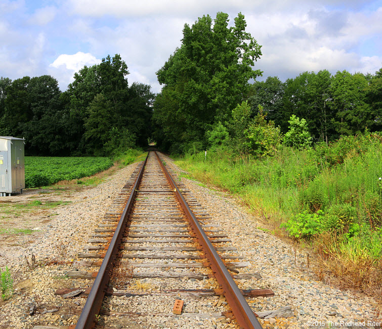 railroad tracks blue sky country