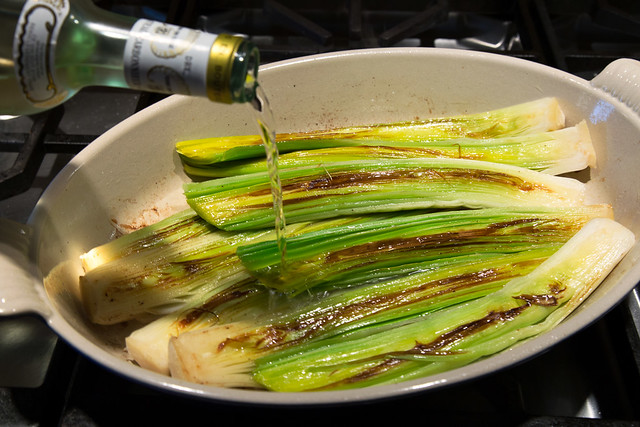 leeks in pan with white wine