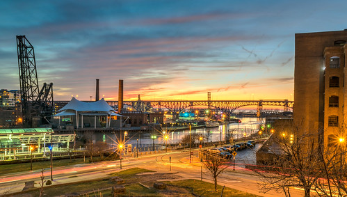 city longexposure bridge trees sunset ohio sky urban reflection tree clouds reflections river geotagged evening nikon downtown cityscape unitedstates outdoor cleveland lighttrails hdr cuyahogariver lightstream theflats nikond5300