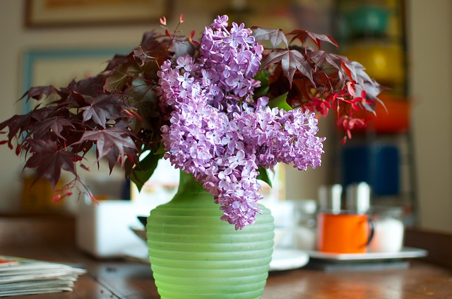 lilacs in a green bottle