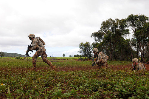 <p>U.S. Soldiers assigned to 3rd Squadron, 4th Cavalry Regiment, 3rd Brigade Combat Team, 25th Infantry Division charge out of a gulch toward a breach in a simulated enemy's perimeter during a company-level combined arms live-fire exercise at Schofield Barracks, Hawaii, May 13, 2013. The exercise develops leaders and service members with critical thinking and tactical skills, while remaining prepared to support the Army's mission in the Pacific. (DoD photo by Sgt. Brian C. Erickson, U.S. Army/Released)</p>